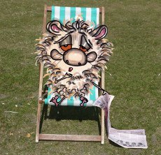 Harrison dozing off on a deckchair whilst reading a newspaper